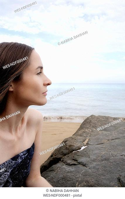Spain, Ibiza, profile of woman on the beach