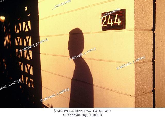 Shadow of man at motel