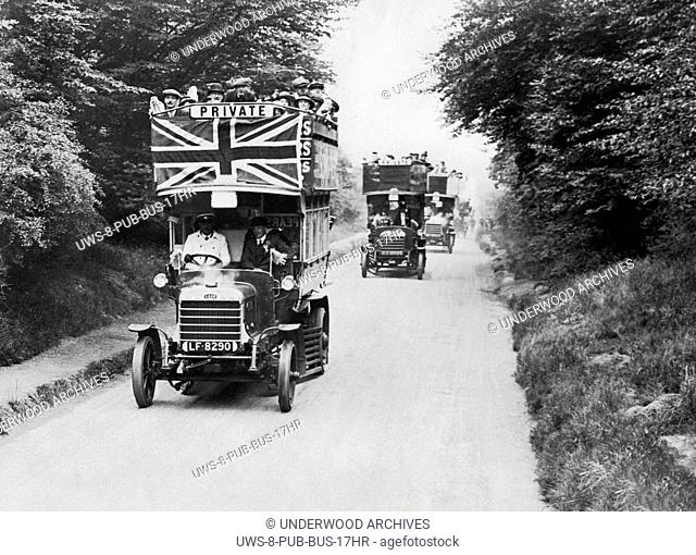 Waltham Abbey, England: c. 1916.Several double decker buses on a driving tour through the Epping Forest