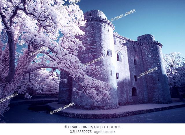 A false colour infrared image of Nunney Castle and moat in the village of Nunney, Somerset, England