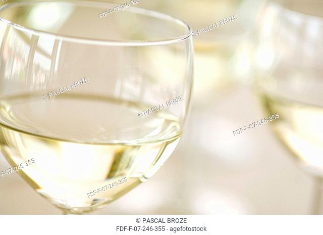 Close-up of two glasses of white wine