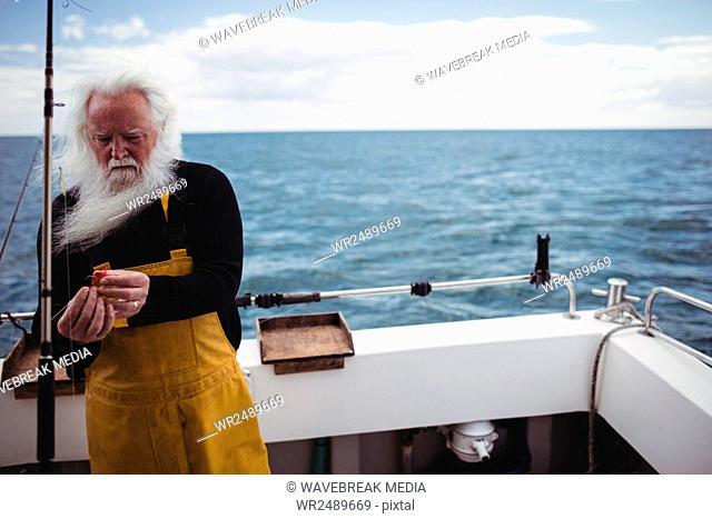 Fisherman preparing fishing rod