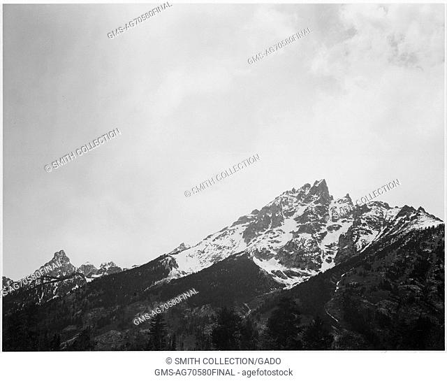 Black and white photograph, snow covered peak, captioned 'In Grand Teton National Park', by Ansel Adams, from Photographs of National Parks and Monuments