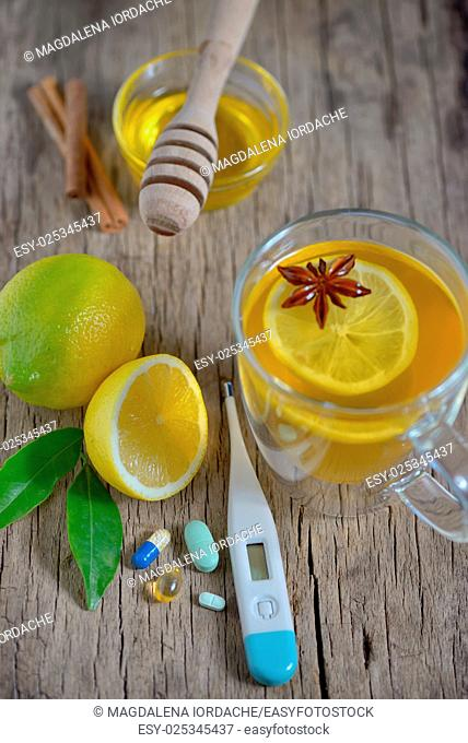 Traditional medicine and flu concept - cup of tea with lemon and honey