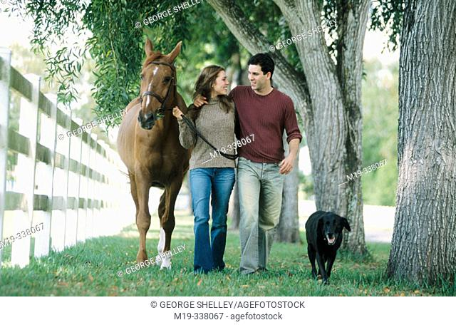 Couple with dog and horse