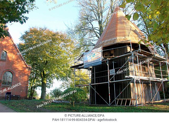 03 November 2018, Schleswig-Holstein, Delve: The separately standing bell tower of St. Mary's Church. The tower is regarded as one of the oldest free-standing...