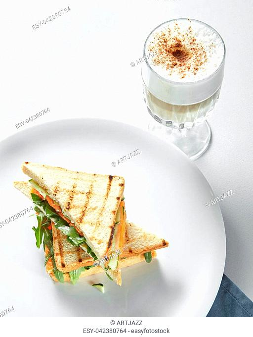 Breakfast concept - cup of coffee with toasts at the white background