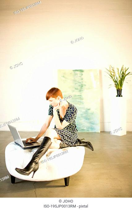 Woman in gallery or loft