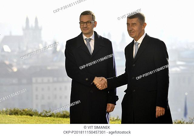 Czech Prime Minister Andrej Babis (right) and Polish Prime Minister Mateusz Morawiecki shake hands prior to joint session of Czech and Polish cabinets in Prague