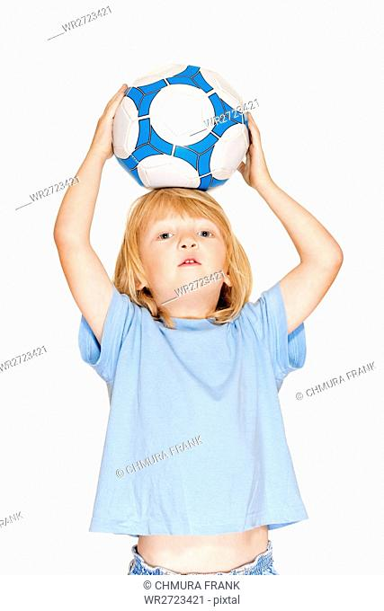 boy with long blond hair holding a football - isolated on white