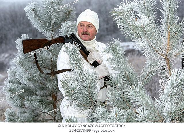 4a0c2338541e4 Suit winter hunting Stock Photos and Images | age fotostock