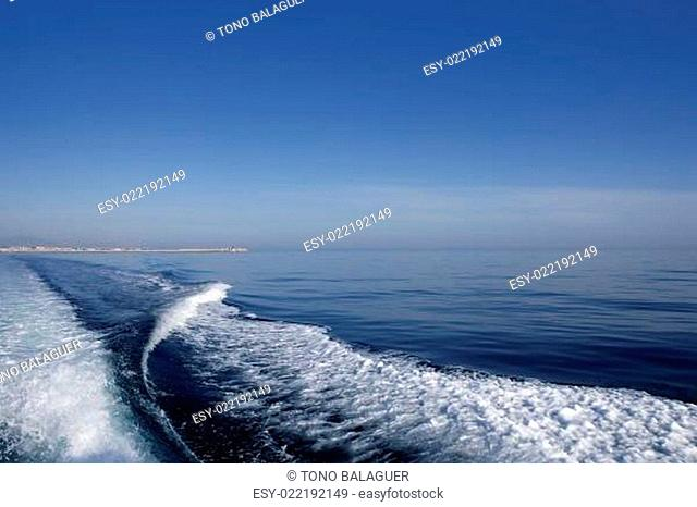 Blue sea ocean with boat wake, prop wash foam
