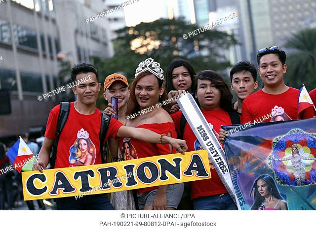 21 February 2019, Philippines, Manila: Fans at the welcome parade for Miss Universe, the Filipina Catriona Gray, on her return to Manila