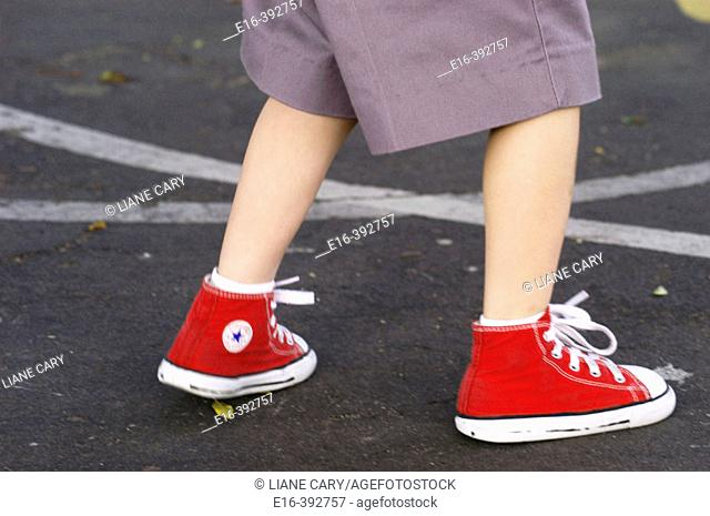 Schoolboy with red tennis shoes