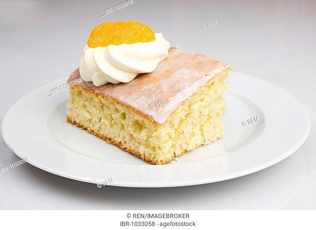 Lemonade cake with cream, mandarine, cup of coffee