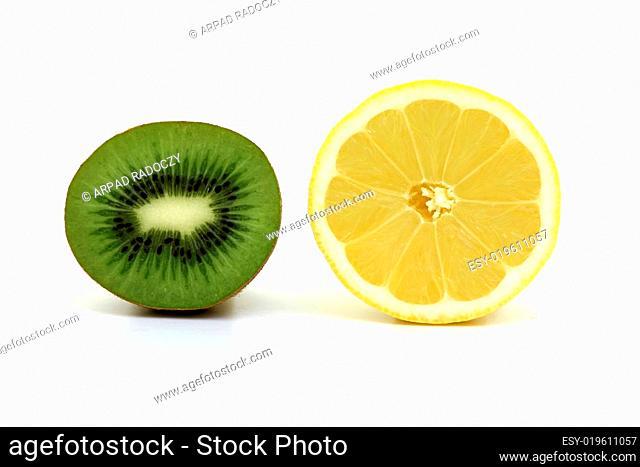 Delicious lemon and kiwi slices on a white background