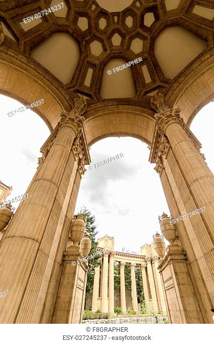 A view of the dome rotunda of the Palace of Fine Arts in San Francisco, California, United States of America. A colonnade roman greek architecture with statues...