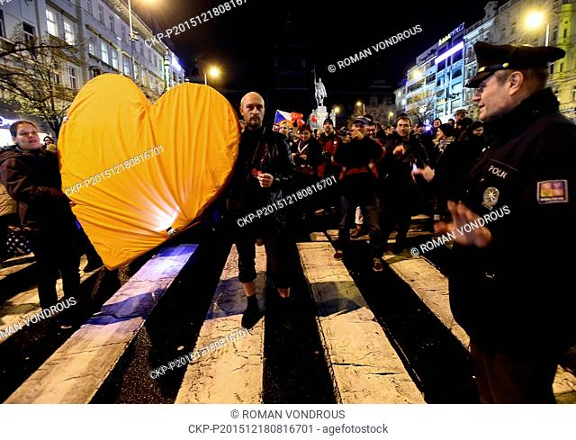 People hold heart during the commemorative march marking fourth anniversary of death of former president Vaclav Havel (1936-2011) entitled Heart to the Castle -...