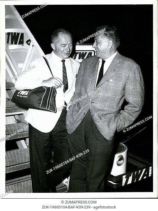 1968 - Idlewild Airport, N.Y., -- Leland Hayward, (right) and Billy wilder, pause on Completion of the first Leg of the their Trip to Paris Retracing...
