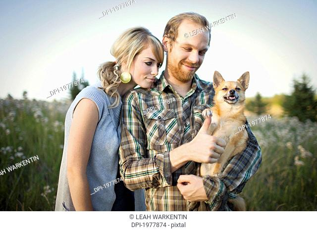 a couple with their dog, edmonton alberta canada