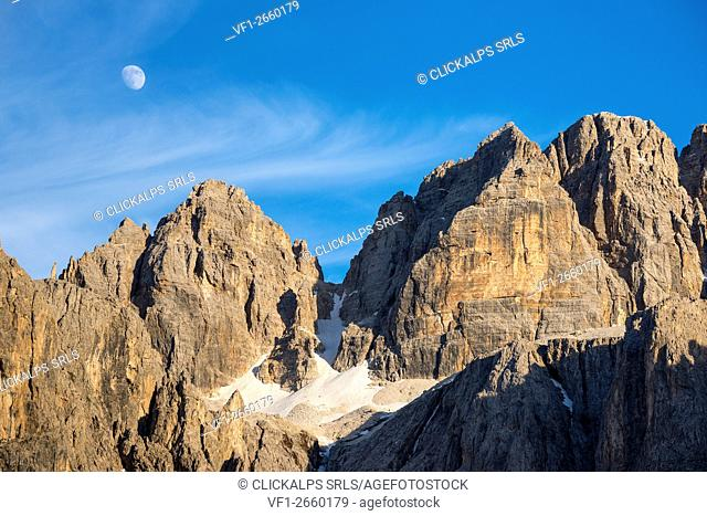Sella, Dolomites, South Tyrol, Italy. The moon over the peak od Sas da Lech