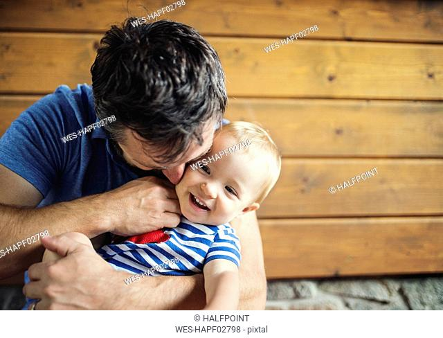 Father tickling happy baby girl