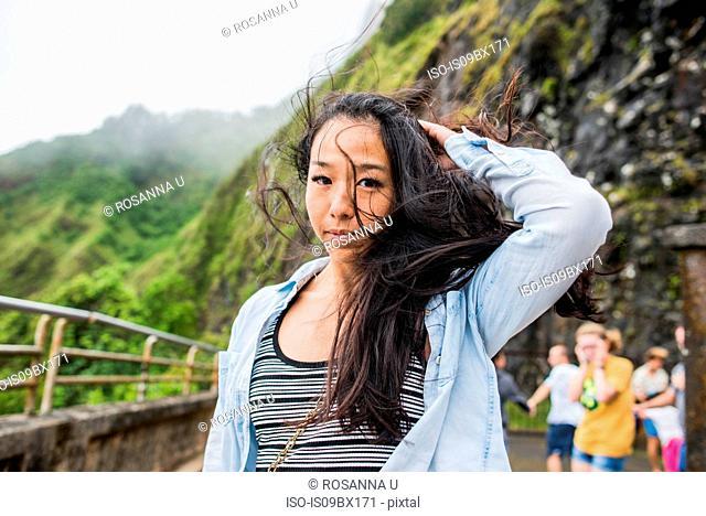 Woman with windswept hair, Nu'uanu Pali Lookout, Oahu, Hawaii