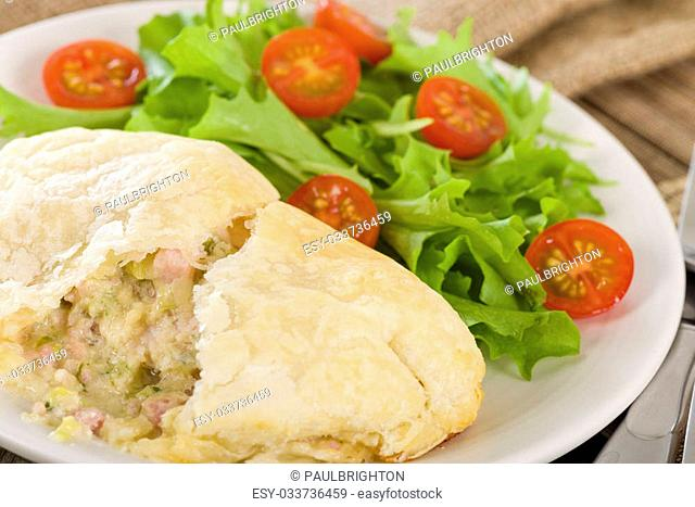 Chicken en Croute - Chicken breast fillet with cheese, bacon and leeks in a creamy sauce wrapped in puff pastry. Served with new potatoes and asparagus tips