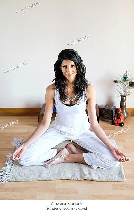 Women in lotus position during yoga