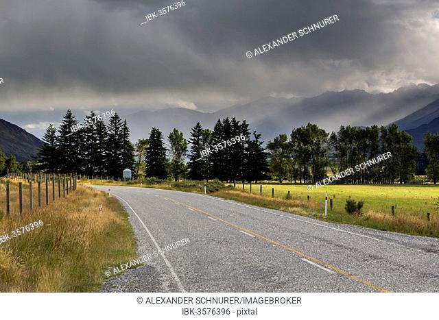Highway, rain clouds above Lake Wanaka, Makarora, Otago Region, New Zealand