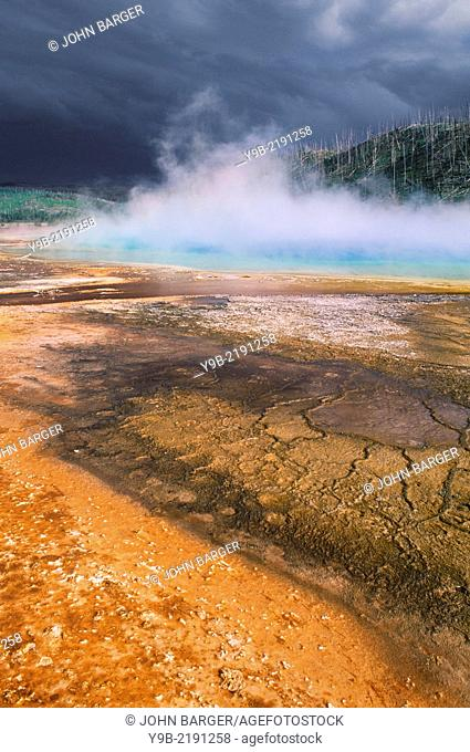 Grand Prismatic Spring with colorful algae and approaching storm clouds, Midway Geyser Basin, Yellowstone National Park, Wyoming, USA