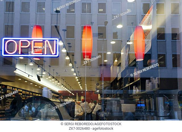 Neon sign advertising fresh coffee at a delicatessen in New York on Sunday, USA