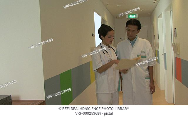 Doctors reading a file
