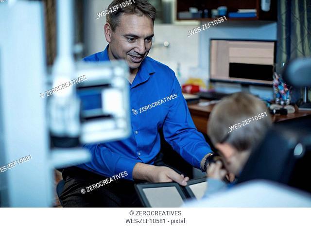 Boy doing eye test at optometrist