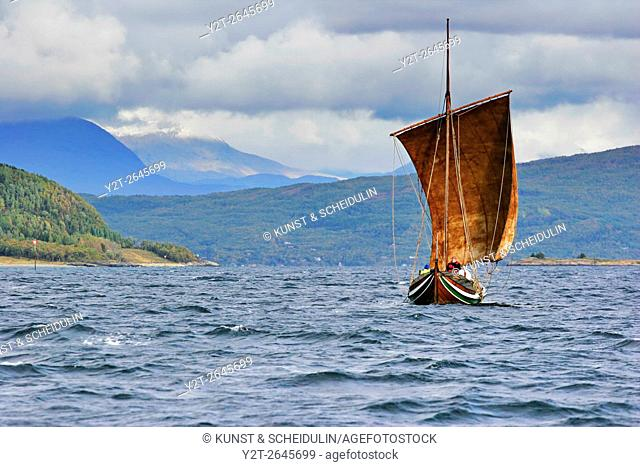 A traditional wooden Nordland boat is sailing on Ofotfjorden in northern Norway