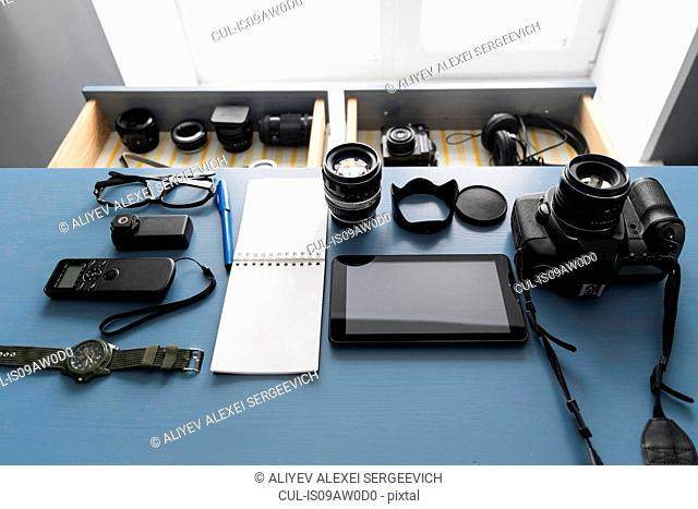 Overhead view of digital tablet and camera equipment on studio desk