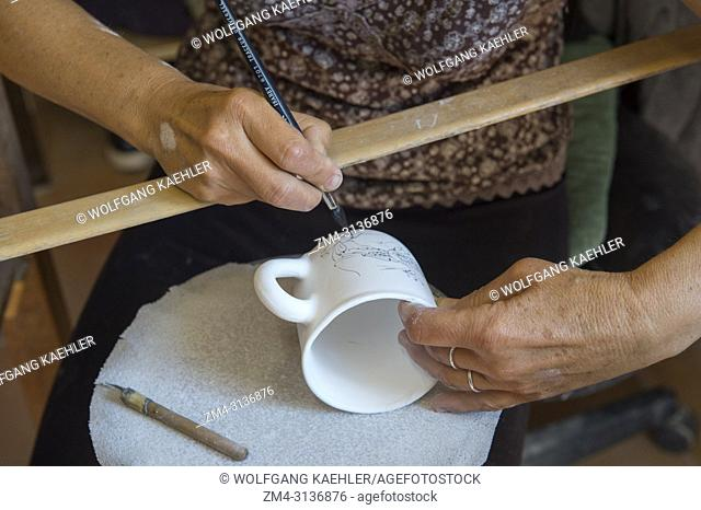 Handmade faience earthenware is being painted at the Atelier Soleil, which is among the oldest and most authentic ceramic workshops in Provence
