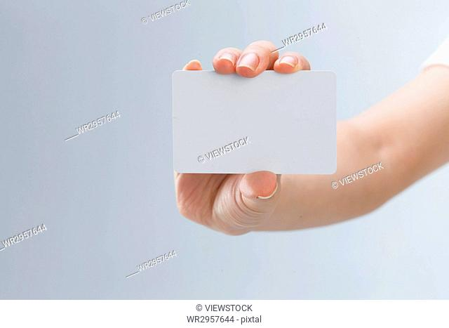 The hand holding the card