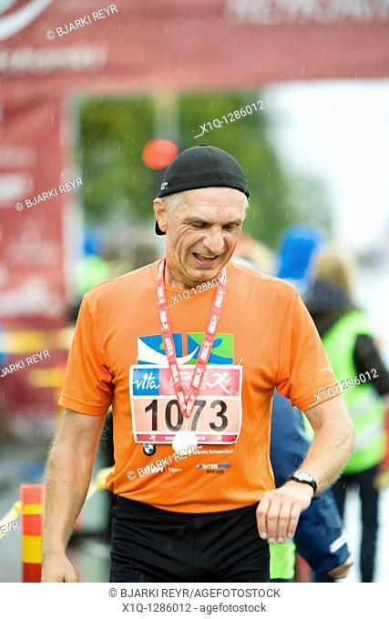 2009 Reykjavik Marathon, Johann Nuber from Germany at the finish line, runner in half-marathon  Reykjavik Iceland