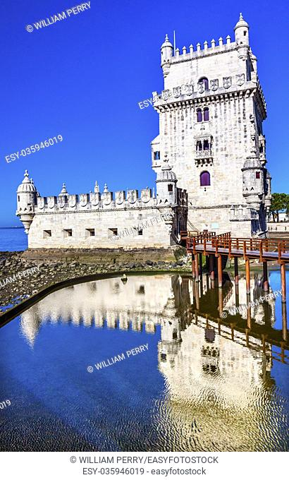 Belem Tower Torre de Belem Portuguese Symbol of Exploration Reflection Lisbon Portugal. Belem Tower was constructed in early 1500s on Tagus River and last point...
