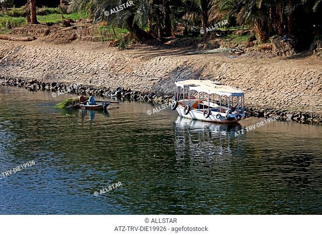 MUSLIM MAN & BOY IN ROWING BOAT; RIVER NILE, EGYPT; 09/01/2013