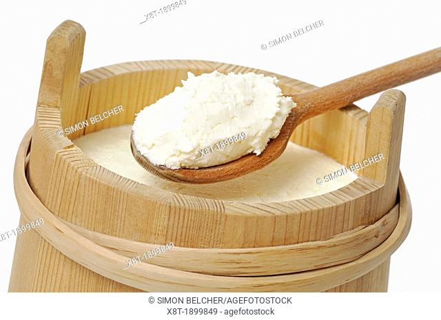 Cream in a Traditional Wooden Pail