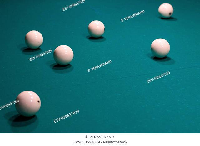 Close-up of Russian billiard: ball, on green game table
