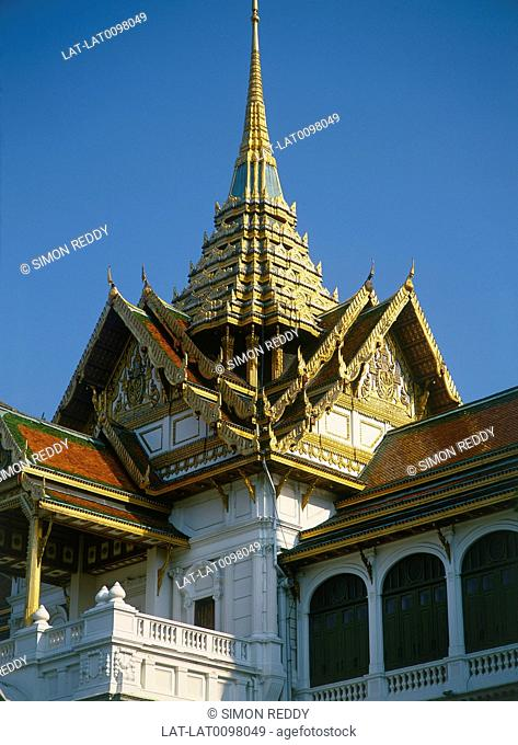 Grand Palace. Dusit Throne hall. Traditional steep roofs,tower. Gold decorations