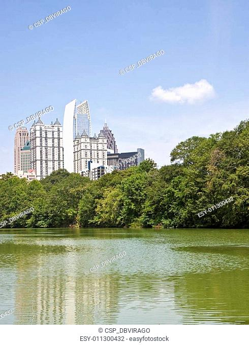 Atlanta towers and Cloud Past Green Lake