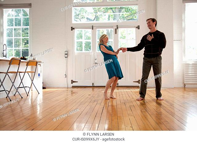 Couple dancing in dance studio