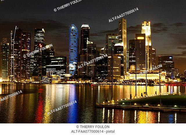Singapore, waterfront skyline viewed from esplanade at night