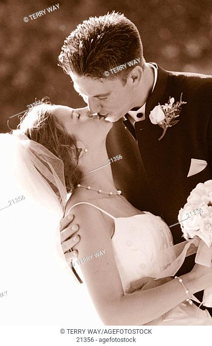Sealed with a kiss. Wedding couple in black and white