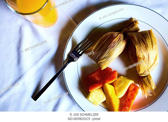 Overhead view of plate with leaf wrapped food and vegetables, Antigua, Guatemala