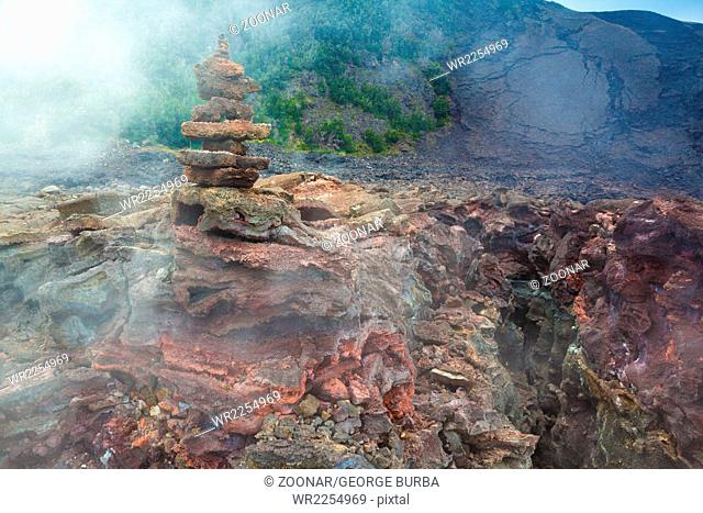 Toxic sulfur fumes and volcanic vents at the barren bottom of Kilauea Crater in Hawaii Volcanoes National Park